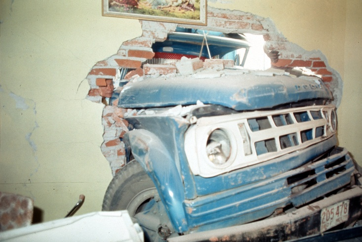 Enrique Metinides: Untitled (Pick-up truck inside a house after a collision at the Colony at Santa Fe), 1978